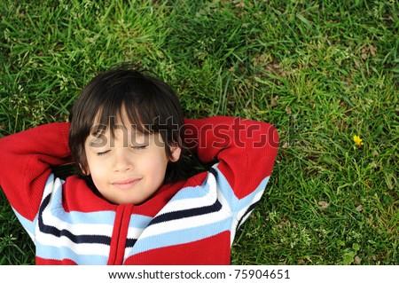 Happy children in grass - stock photo