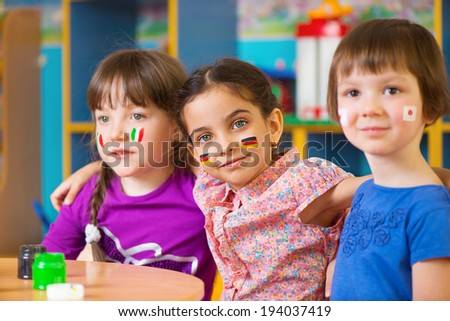 Happy children in language camp studying geography - stock photo