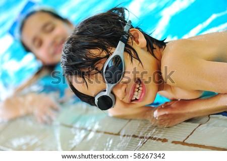 Happy children in pool - stock photo