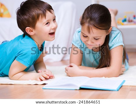 Happy children is reading book