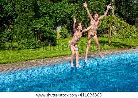 Happy children jump to swimming pool, fun on summer vacation  - stock photo