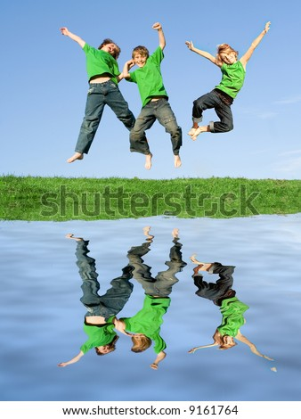 happy children jumping for joy                    ONLY 2 CHILDREN USED FOR THIS IMAGE - stock photo