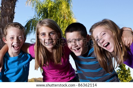 Happy children laughing and smiling together
