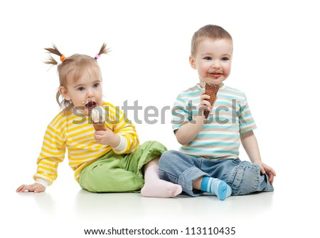 happy children little girl and boy eating ice cream in studio isolated