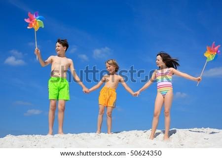 Happy children on beach - stock photo