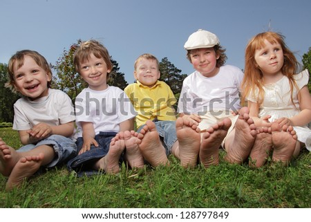 happy children on grass outdoors - stock photo