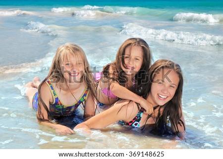 Happy children on the beach - stock photo