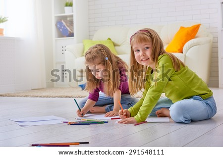 happy children paint together - stock photo
