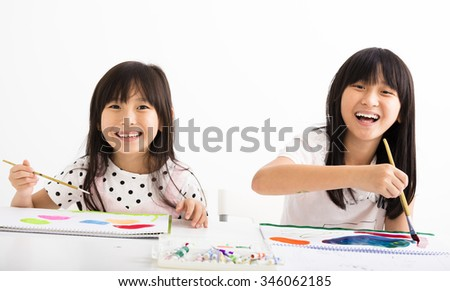 happy children painting in the classroom - stock photo