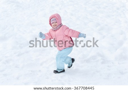 Happy children play outdoors in snow. Little girl enjoying a winter. Kids sled in the Alps mountains in winter. Outdoor fun  - stock photo