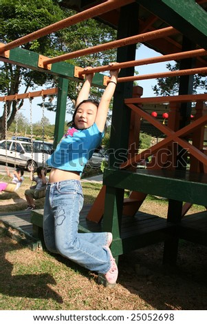Happy children playing at the playground in the park on sunny day - stock photo