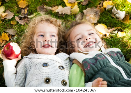 Happy children playing in autumn park on family picnic - stock photo
