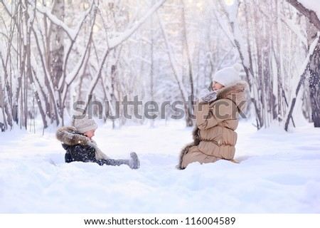happy children playing in the snow - stock photo