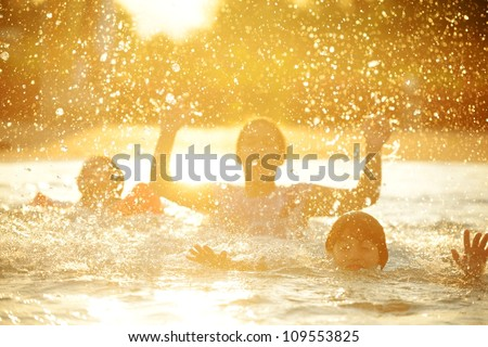 Happy children playing on hot summertime - stock photo