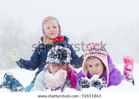 Happy children playing on snow