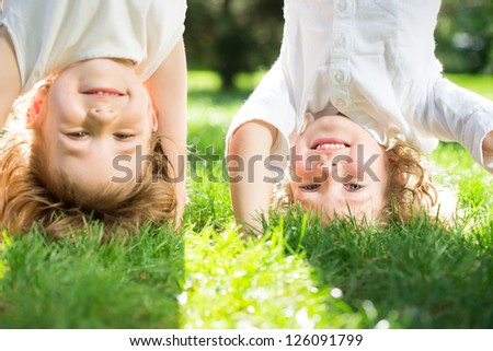 Happy children playing outdoors in spring park - stock photo