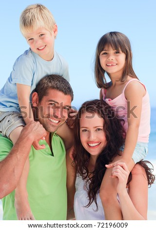 Happy children playing with their parents - stock photo