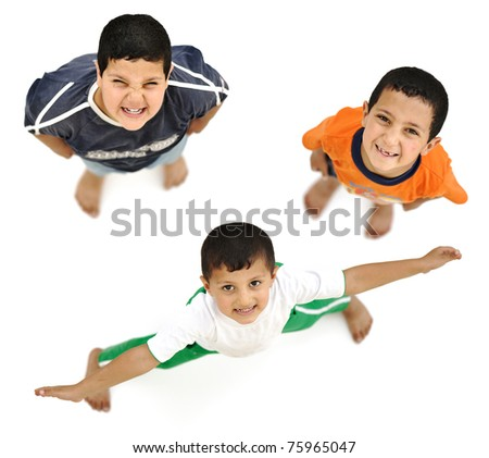 Happy children, positive fresh  smiling boys from above, different angle, isolated on white, full body - stock photo