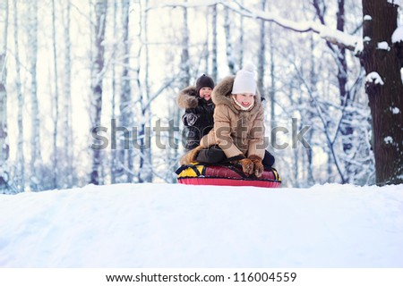 happy children riding the hills, lots of snow - stock photo
