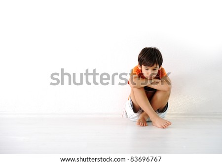 Happy children sitting at home, indoor - stock photo
