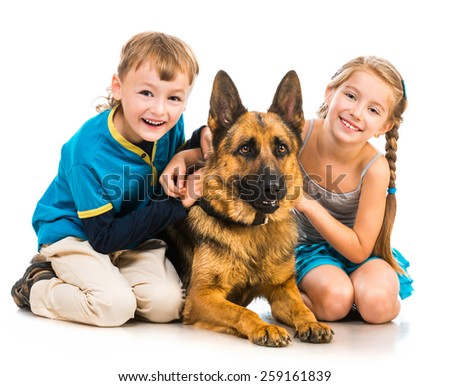 happy children with a shepherd dog isolated  on white - stock photo