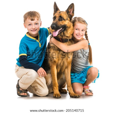 happy children with a shepherd dog on a white background - stock photo