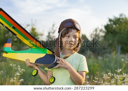 happy children with airplan toy outdoors (airplane is hand made not copyright) - stock photo