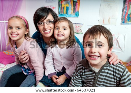 Happy children with their mother - stock photo