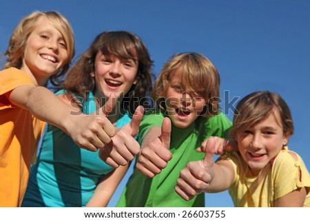 happy children with thumbs up - stock photo