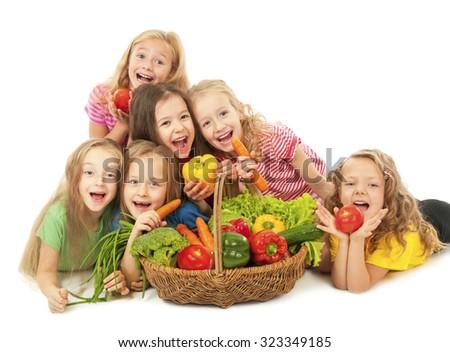 Happy children with vegetables - stock photo