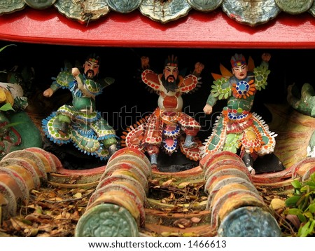 Happy Chinese Gods on Roof - stock photo