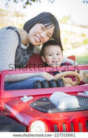 Happy Chinese Mother Having Fun with Her Mixed Race Baby Son. - stock photo
