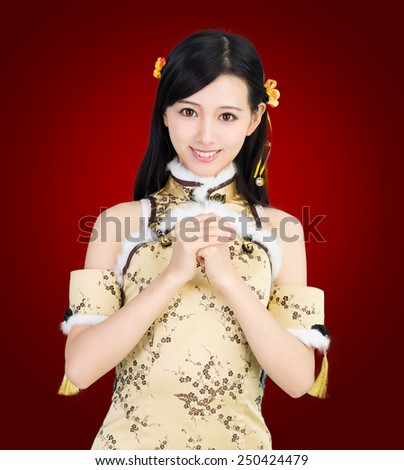 happy Chinese new year. Asian woman in gold gesture , congratulation on red background  - stock photo