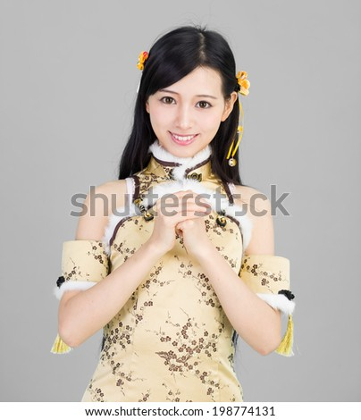 happy Chinese new year.  Asian woman with gesture of congratulat - stock photo