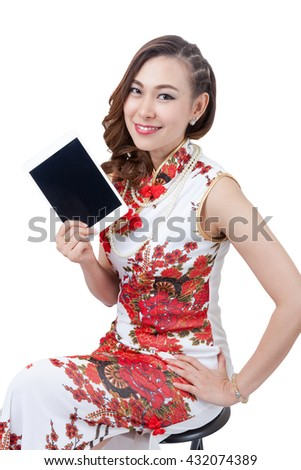Happy Chinese new year. beautiful young Asian woman holding tablet pc with empty screen Smiling mixed chinese asian / caucasian woman. Isolated on white background. / have clipping path.  - stock photo