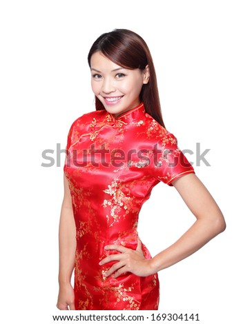 happy Chinese new year. beautiful young Asian woman with gesture of congratulation - stock photo