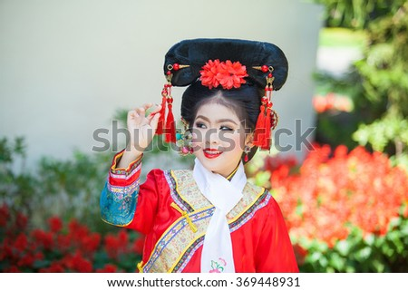 Happy Chinese new year concept . smiling  little girls Traditional Chinese dress. (Place Public Temple in Thailand ,Traditional Chinese dress is common in Thailand and is not subjected to copyright) - stock photo