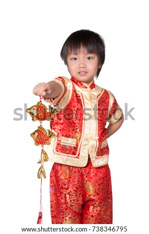 Happy Chinese new year. Cute Asian boy in cheongsam of traditional chinese dress in clipping path on isolated white background. Little kid holding red fish and standing wear red Chinese-style dress.
