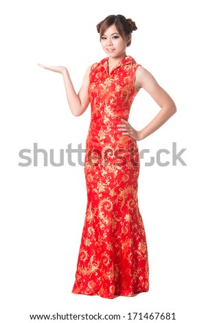 Happy Chinese new year,Smiling Chinese woman dress traditional cheongsam and introduce,studio shot isolated on white background. - stock photo