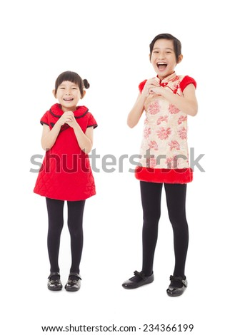 happy chinese new year. smiling little girls with congratulation gesture - stock photo