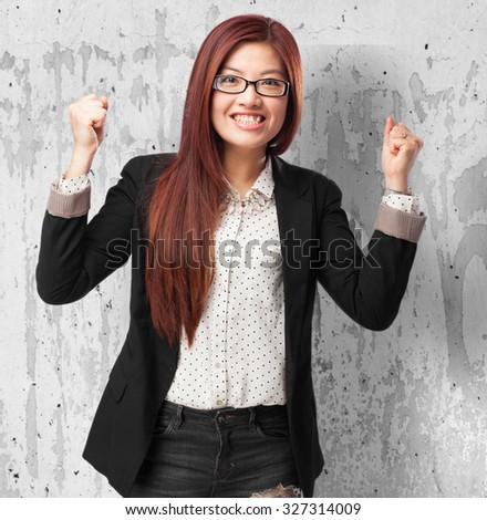 happy chinese woman celebrating gesture - stock photo