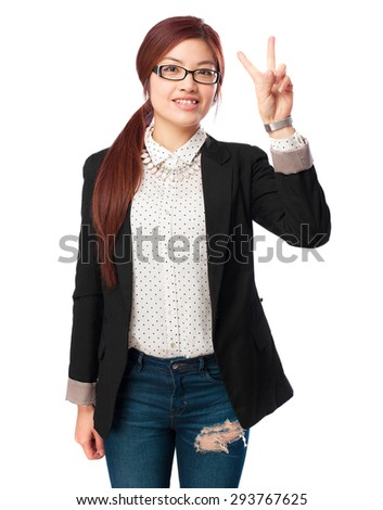happy chinese woman victory gesture - stock photo