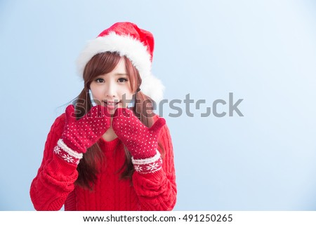 Happy Christmas beauty woman wears red shirt isolated on blue background, asian