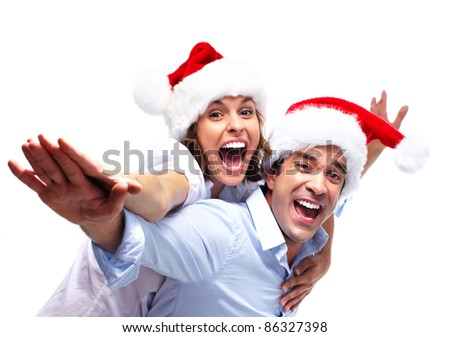 Happy christmas couple. Isolated over white background. - stock photo