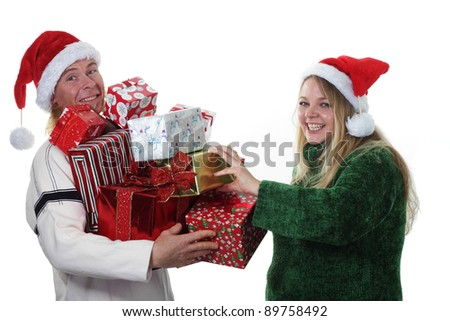 Happy Christmas couple piling gifts into their arms