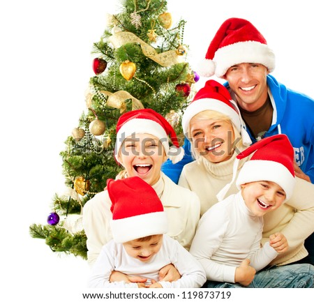 Happy Christmas Family. Big Family with Kids Celebrating Christmas. New Year. Christmas Tree. Smiling Children and Parents isolated on a White Background - stock photo