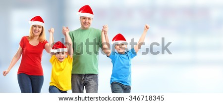 Happy Christmas family over blue background.