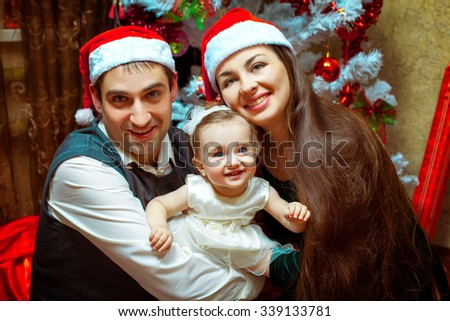Happy christmas family with little baby girl. Christmas mood. New year. - stock photo