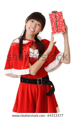 Happy christmas girl holding gift over white background.