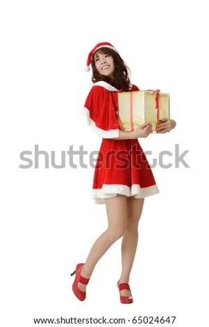 Happy Christmas girl holding gift with smiling isolated over white.